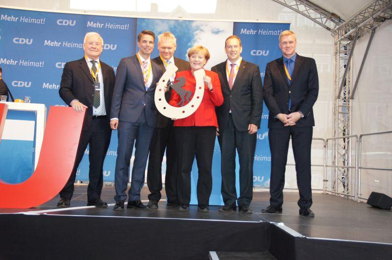 Besuch der Kanzlerin: Unterstützung für den CDU-Kommunalwahlkampf mit Misstönen im Publikum